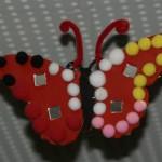 Schmetterling aus Sperrholz mit Pompons und Pfeifenputzer